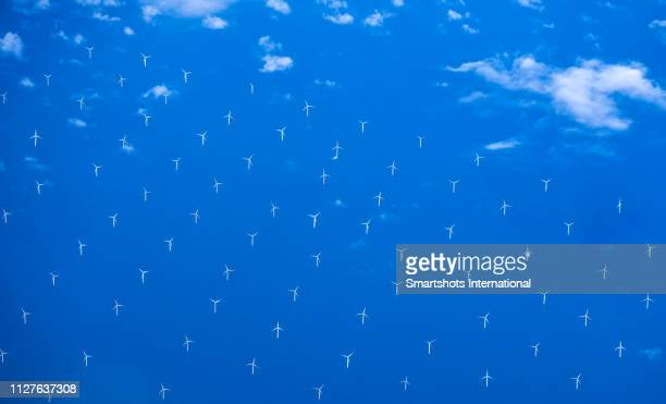 modern windmills in an offshore wind farm in northern europe - generic location stock pictures, royalty-free photos & images