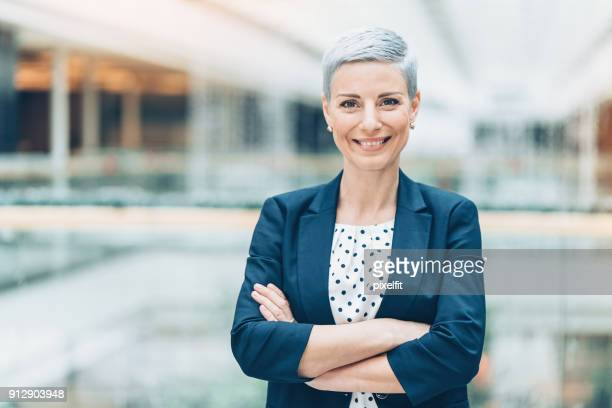 modern woman in business - employment law stock photos and pictures