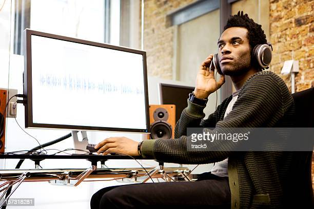 modern workplace: audio engineer in his sound production studio