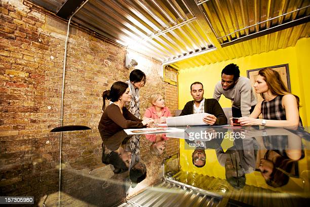 modern workplace: candid office meeting in a contemporary board room