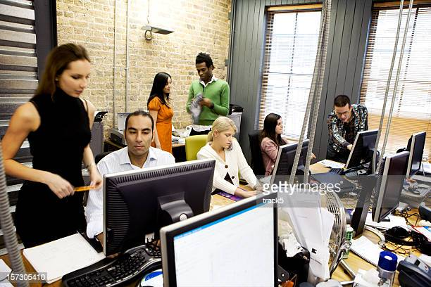 modern workplace: contemporary open plan office with diverse professional team