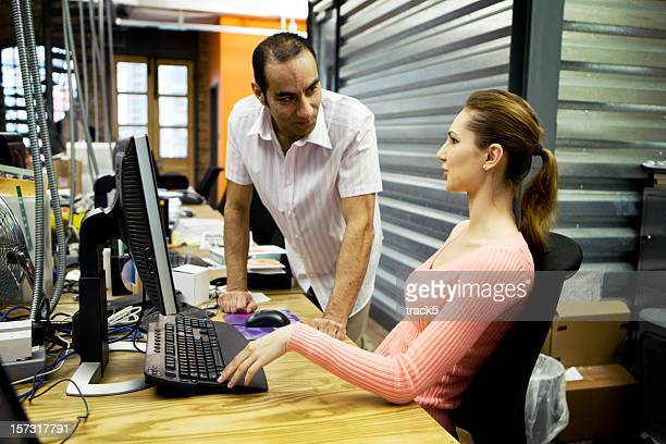 modern workplace: creative office colleagues in discussion