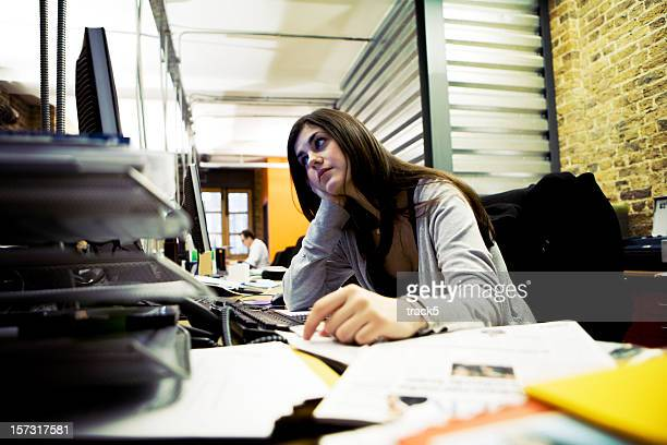 modern workplace: creative professional struggling with her workload