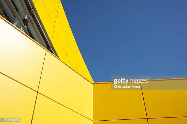 Modern Yellow Architecture Against Blue Sky