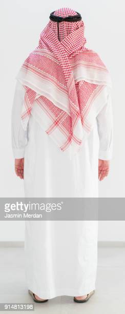 modern young arabian man - rear view - ceremonial robe stock pictures, royalty-free photos & images