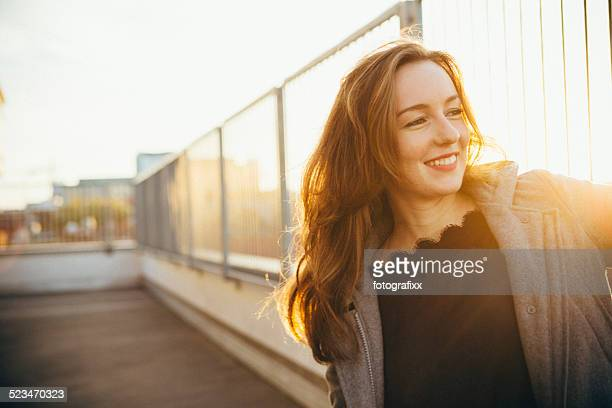 modern young woman portrait in urban scene with back lit