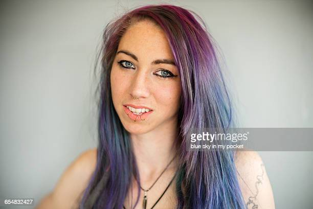 A modern young woman with purple hair