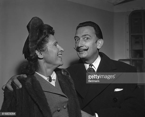 Modernistic artist Salvador Dali amuses his wife Gala with a display of his handlebar moustache The painterwriter and spouse arrived in New York Dec...