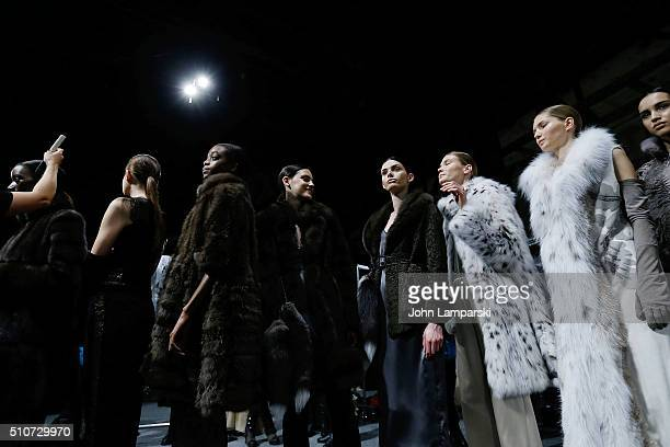 Mode;s prepare backstage during the Dennis Basso Fall 2016 show New York Fashion Week: The Shows at The Arc, Skylight at Moynihan Station on February...