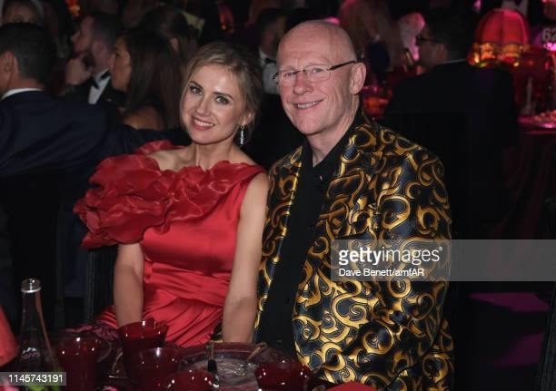 Modesta Vzesniauskaite and John Caudwell attend the amfAR Cannes Gala 2019 at Hotel du CapEdenRoc on May 23 2019 in Cap d'Antibes France