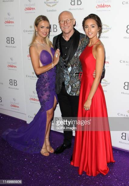 Modesta Vzesniauskaite, John Caudwell and Emily Andre arrive for the Caudwell Children Butterfly Ball charity event at the Grosvenor House, Park Lane.