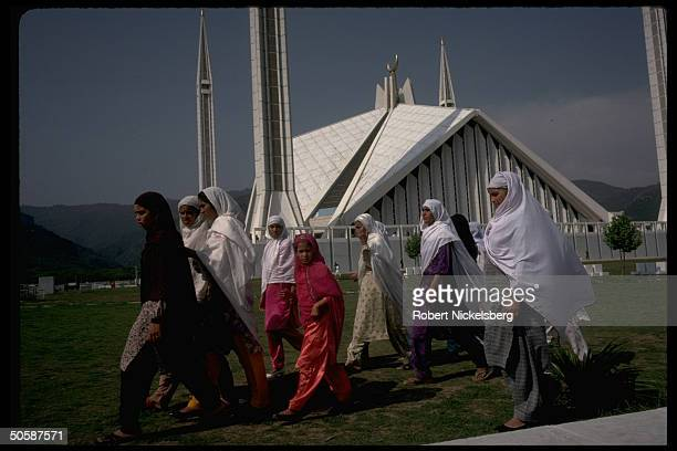 Modestly veiled Moslem women girls prob outside Faisal Mosque after services