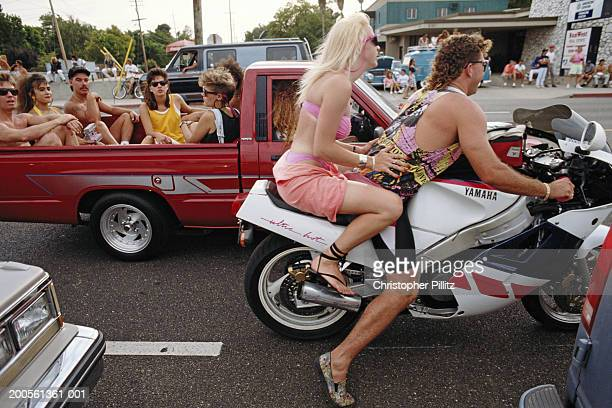 USA, CA, Modesto, group of people cruising in cars and on motorbikes