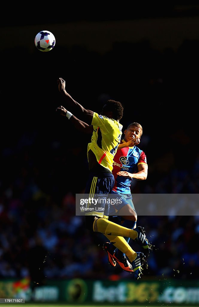 Modibo Diakite of Sunderland is tackled by Dwight Gayle of Crystal Palace during the Barclays Premier League match between Crystal Palace and Sunderland at Selhurst Park on August 31, 2013 in London, England.