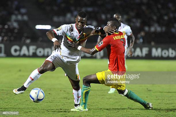 Modibo Maiga of Mali vies against Issiaga Sylla of Guinea during the Africa Cup of Nations Group D match between Guinea and Mali in Mongomo...