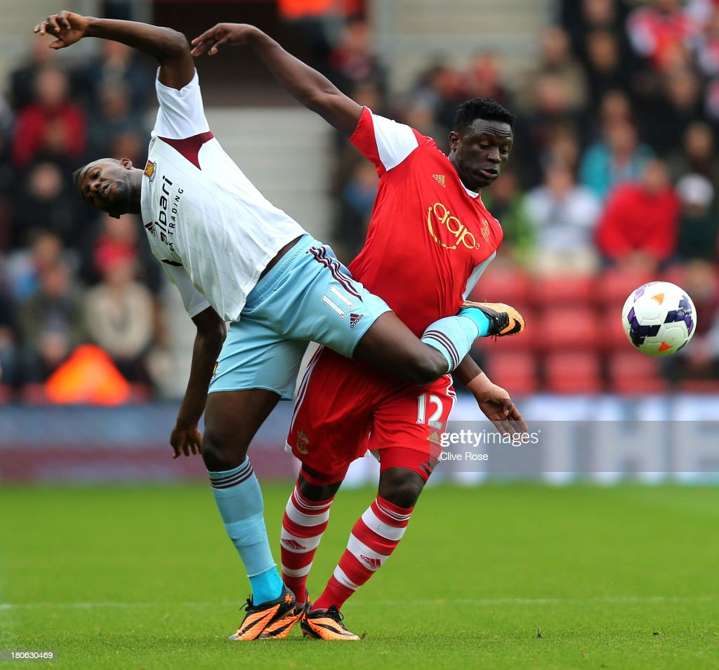 Modibo Maiga of West Ham and Victor Wanyama of Southampton compete for the ball during the Barclays Premier League match between Southampton and West Ham United at St Mary's Stadium on September 15, 2013 in Southampton, England.