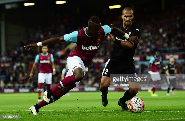 Modibo Maiga of West Ham battles for the ball with Geraldo Alves of Astra Giurgiu during the UEFA Europa League third qualifying round match between...