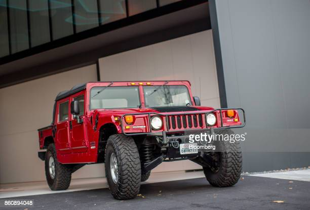 A modified electric Hummer H1 sport utility vehicle stands on display at the Kreisel Electric GmbH research center and battery assembly plant in...