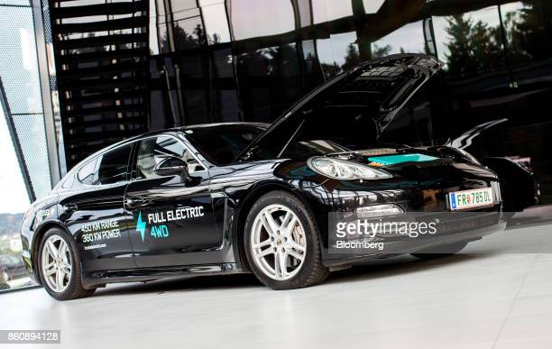 A modified electric Porsche AG Panamera automobile stands on display with its hood opened at the Kreisel Electric GmbH research center and battery...