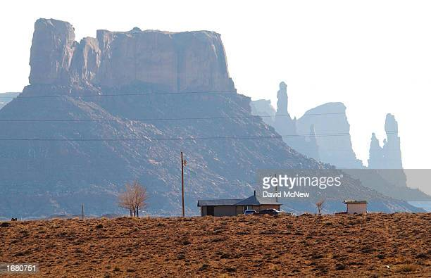 A modified hogan a traditional fivetoeightsided Navajo house stands near sandstone formations near Little Round Rock December 5 2002 on the Navajo...