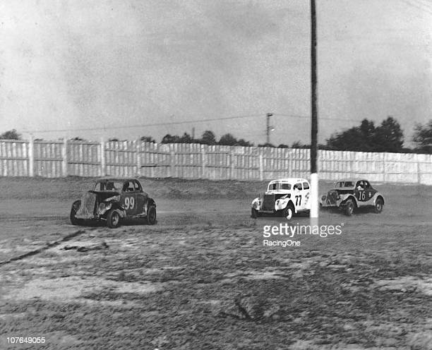 Modified stock cars negotiated a turn during a 1950s race at GreenvillePickens Speedway