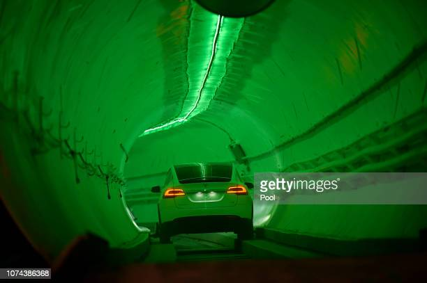 Modified Tesla Model X drives in the tunnel entrance before an unveiling event for The Boring Company Hawthorne test tunnel December 18, 2018 in...