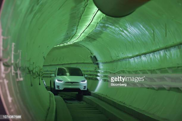 Modified Tesla Model X electric vehicle carrying Elon Musk, co-founder and chief executive officer of Tesla Inc., drives through the tunnel as it...