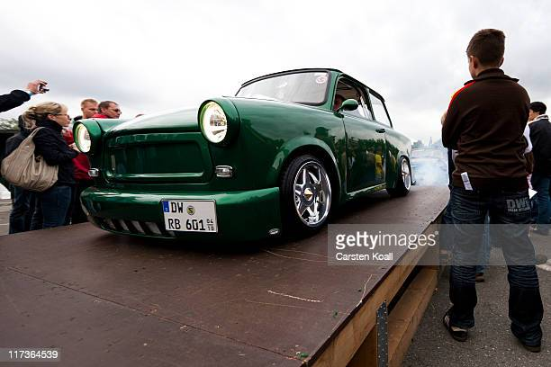 Modified Trabant cars drive on a tribune during a parade as fans and owners of East Germanera Trabant cars gather at the 2011 International...