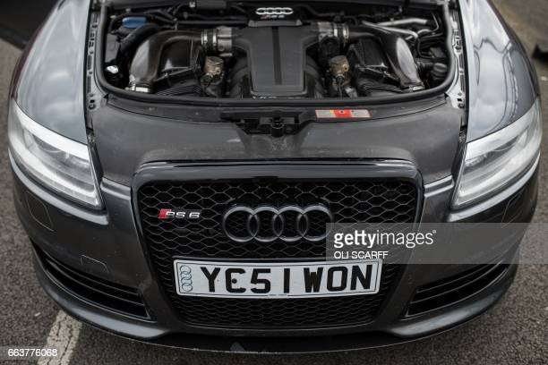A modified vehicle with a personalised number plate is displayed at The Fast Show performance car event held at the Santa Pod Raceway near...