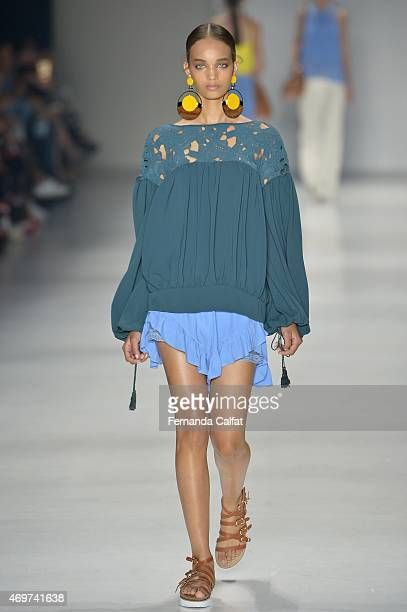 A modl walks at Juliana Jabour runway during SPFW Summer 2016 at Parque Candido Portinari on April 14 2015 in Sao Paulo Brazil