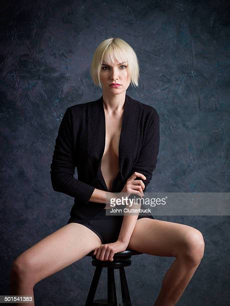 modle on a stool - legs spread open stock photos and pictures