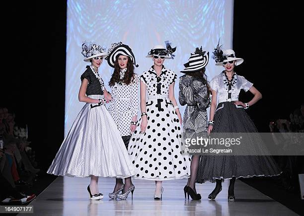 Modles walk the runway at the Slava Zaitsev show during MercedesBenz Fashion Week Russia Fall/Winter 2013/2014 at Manege on March 29 2013 in Moscow...