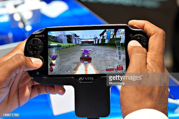 Road Trip is demonstrated on a Sony PlayStation Vita gaming device during a Sony Corp event ahead of the official opening of the 2012 International...