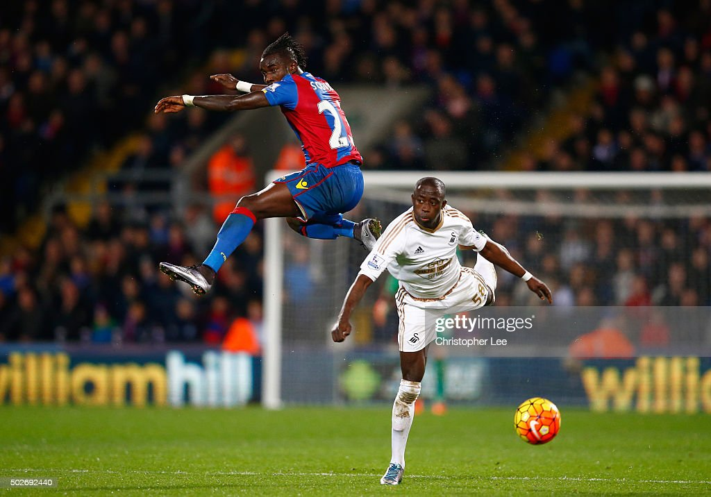 Modou Barrow of Swansea City and Pape N'Diaye Souare of Crystal Palace compete for the ball during the Barclays Premier League match between Crystal Palace and Swansea City at Selhurst Park on December 28, 2015 in London, England.