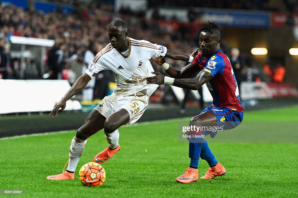 Modou Barrow of Swansea City and Pape N'Diaye Souare of Crystal Palace compete for the ball during the Barclays Premier League match between Swansea City and Crystal Palace at the Liberty Stadium on February 6, 2016 in Swansea, Wales.