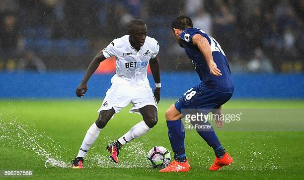 Modou Barrow of Swansea City attempts to take the ball past Christian Fuchs of Leicester City during the Premier League match between Leicester City...