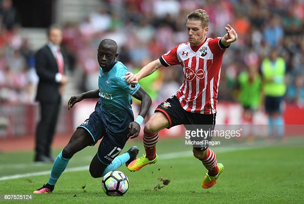 Modou Barrow of Swansea City is chased down by so8 during the Premier League match between Southampton and Swansea City at St Mary's Stadium on...