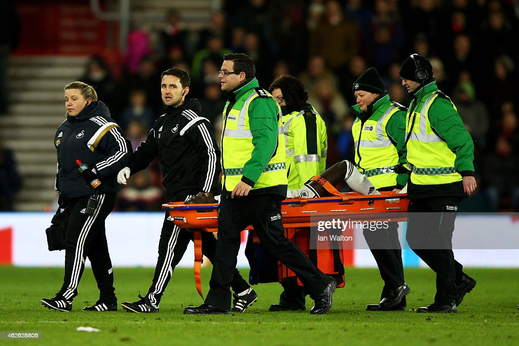 Modou Barrow of Swansea is stretchered of the pitch following a foul by Ryan Bertrand of Southampton during the Barclays Premier League match between Southampton and Swansea City at St Mary's Stadium on February 1, 2015 in Southampton, England. Ryan Bertrand of Southampton received a straight red card for his challenge on Modou Barrow of Swansea.