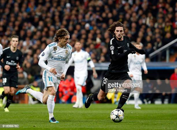 Modric and Adrien Rabiot during the UEFA Champions league round of 16 match first leg football match between Real Madrid and Paris Saint Germain at...