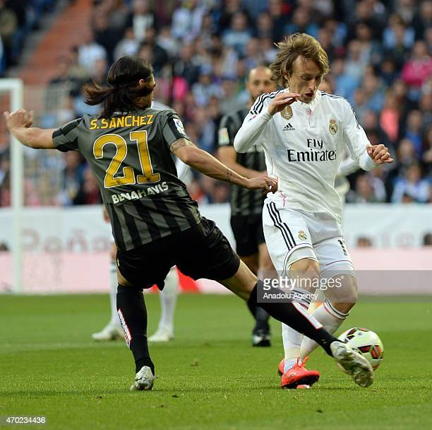 Modric of Real Madrid is in action against Sanchez during the La Liga match between Real Madrid and Malaga at Estadio Santiago Bernabeu in Madrid...