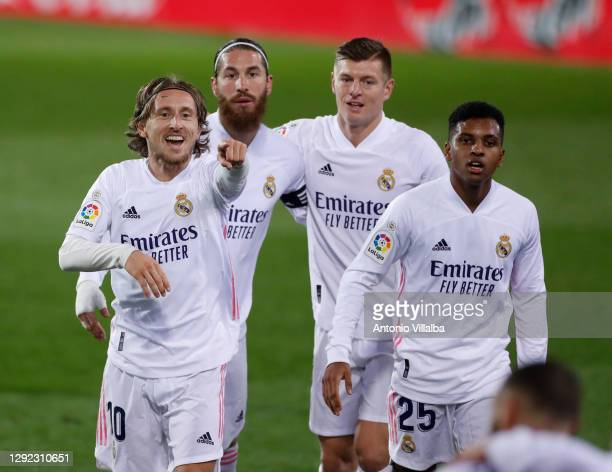 Modric pointing Benzema at the celebration of his goal during the La Liga Santander match between SD Eibar and Real Madrid at Estadio Municipal de...