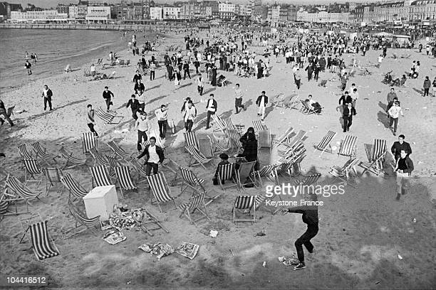 Mods invading the beach during an outbreak of violence with groups of rockers at Margate Kent 18th May 1964