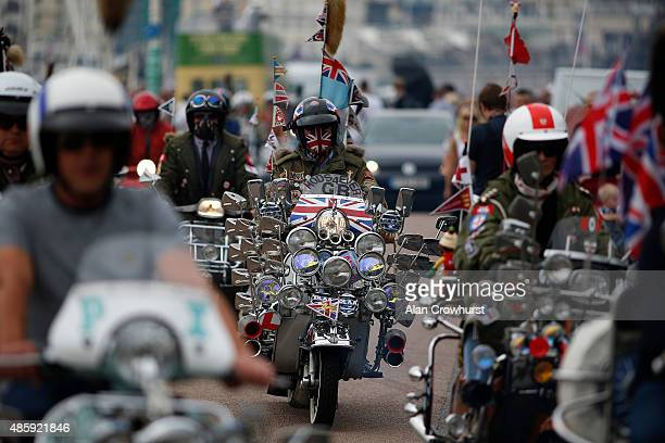 Mods make their way to Eastbourne on their ride out during the Brighton Mod Weekender where mods and their scooters gather on the annual bank holiday...