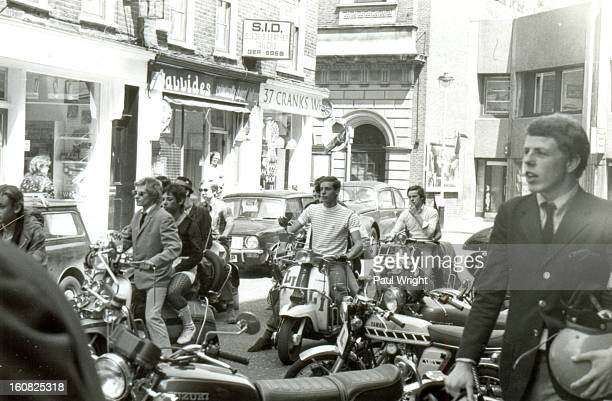 CONTENT] Mods on scooters in the Carnaby Street area of London being filmed for 'Steppin' Out' summer 1979 On the righthand side of the photo is Mick...