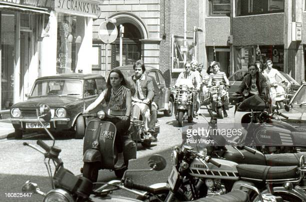 Mods on scooters in the Carnaby Street area of London being filmed for the film: 'Steppin' Out', summer 1979.