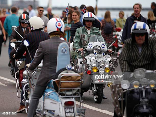 Mods on their scooters during the Brighton Mod Weekender where mods and their scooters gather on the annual bank holiday weekend event on August 30...