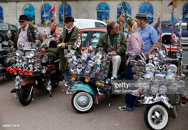 Mods relax during the Brighton Mod Weekender where mods and their scooters gather on the annual bank holiday weekend event on August 30 2015 in...