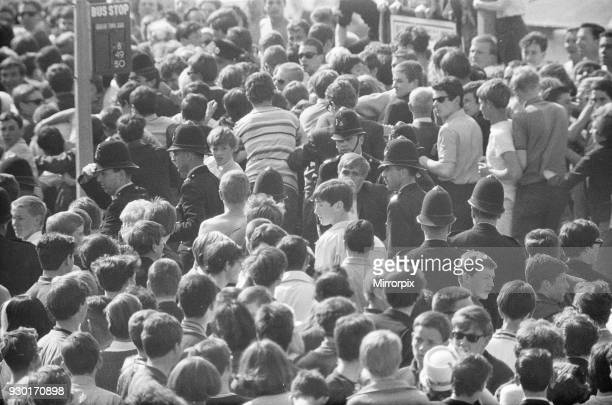 Mods v Rockers Picture shows the scene at Margate North East Kent in May 1964 Police try and keep things calm as the crowds of Mods gather Picture...