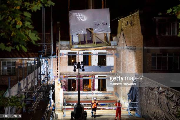 A modular home complete with kitchen and bathroom is lowered into a shell of a building on Park Street on August 11 2019 in Bristol United Kingdom...
