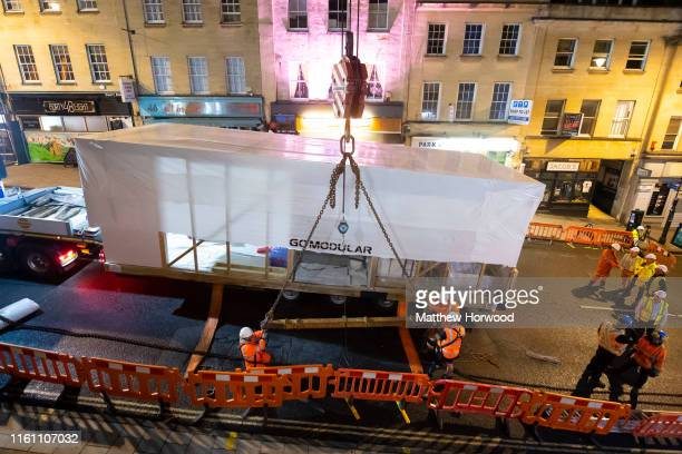 A modular home complete with kitchen and bathroom on a lorry before being lowered into a shell of a building on Park Street on August 11 2019 in...